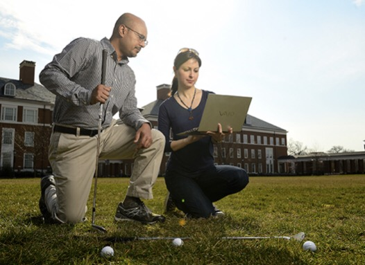 Rajat Mittal, left, a Johns Hopkins mechanical engineering professor, and Neda Yaghoobian, a visiting postdoctoral scholar, devised a supercomputer simulation to determine how wind conditions affect the of trajectory of a golf ball in flight. Photo by Will Kirk/Johns Hopkins University.
