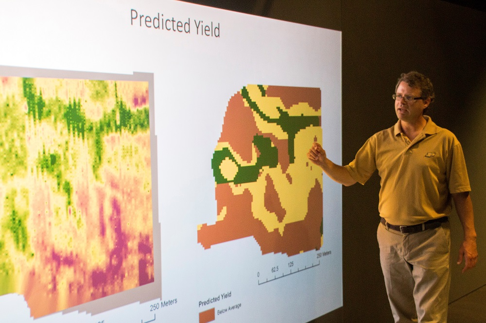 Phillip R. Owens, Purdue University associate professor of agronomy, demonstrates how a farmer's field can be mapped to show predicted crop yield with his technology. His functional soil mapping technology is available for licensing and developing through the Purdue Office of Technology Commercialization.