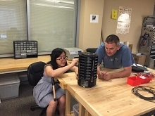 Doctoral student Yan Zhu (left) and Eamonn Keogh, professor of computer science and engineering, adjust a mosquito trap designed by researchers at UCR and Microsoft.