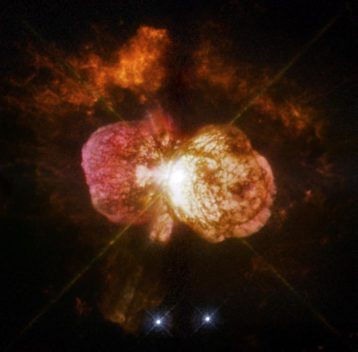 This is Eta Carinae's great eruption in the 1840s created the billowing Homunculus Nebula, imaged here by Hubble. Now about a light-year long, the expanding cloud contains enough material to make at least 10 copies of our sun. Astronomers cannot yet explain what caused this eruption.