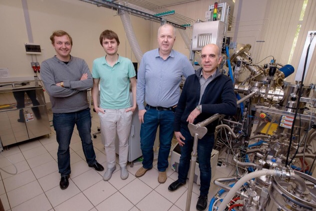 CAPTION (From left) Dmitry Kuzmichev, Konstantin Egorov, Andrey Markeev, and Yury Lebedinskiy posing next to the atomic layer deposition apparatus at the Center of Shared Research Facilities, MIPT